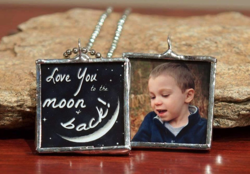 Remembrance charm necklace showing picture of child who passed with quote that ays love you to the moon and back